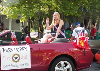 The 2014 Miss Poppy, Lacey, rode in the parade in a Mustang.