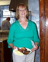 Louise Spicer, ALA member, serving breakfast.