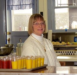 Louise Spicer helps out during the Sunday Community Breakfast.