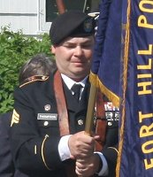 Rob Thompson in the 2016 Memorial Day parade holding the Post 376 colors.