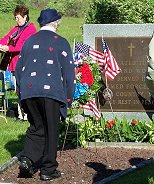 ALA President, Sylvia Witchella placing a wreath at St. Joseph's Cemetery.