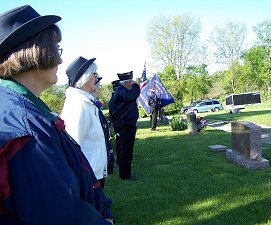 The Legion gives a salute at St. Joseph's cemetery.